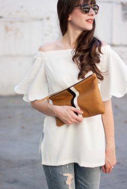Off the shoulder top with flat leather clutch