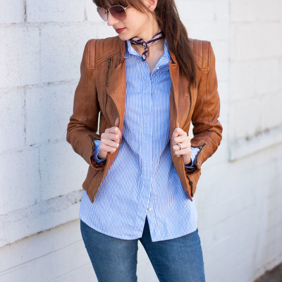 Jessica from Jeans and a Teacup wearing a striped button up, neck scarf and leather jacket