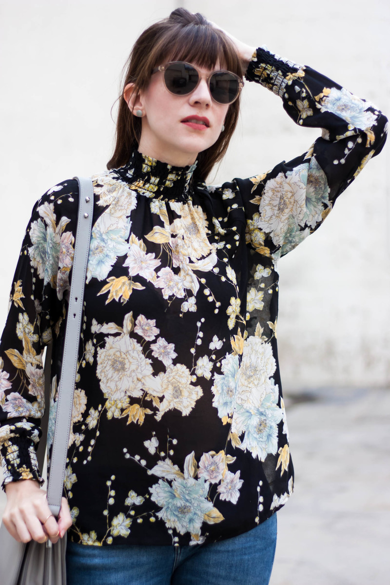 Los Angeles Style Blogger wearing a high neck floral blouse and kate and moose earrings