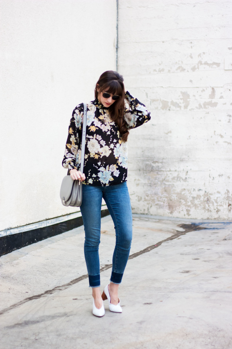 Los Angeles Style Blogger wearing a high neck floral blouse and Loeffler Randall Bag