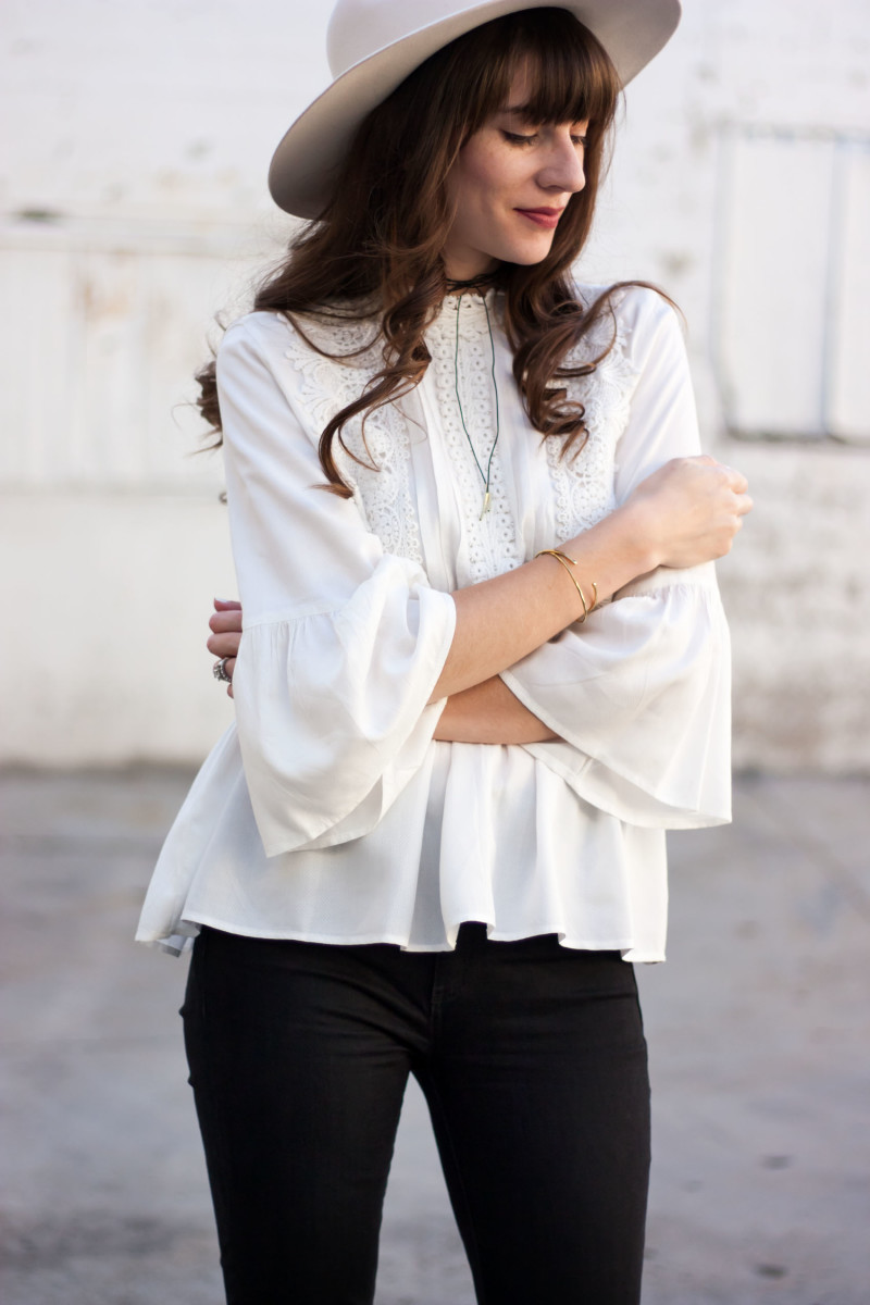 Style Blogger wearing embroidered white blouse, white wool hat and leather choker necklace