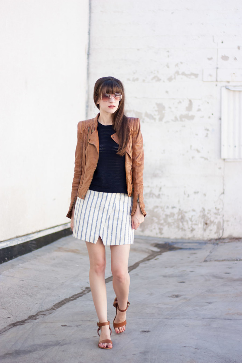 Jeans and a Teacup style blogger wearing tan leather jacket