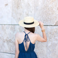 open back denim dress with straw hat