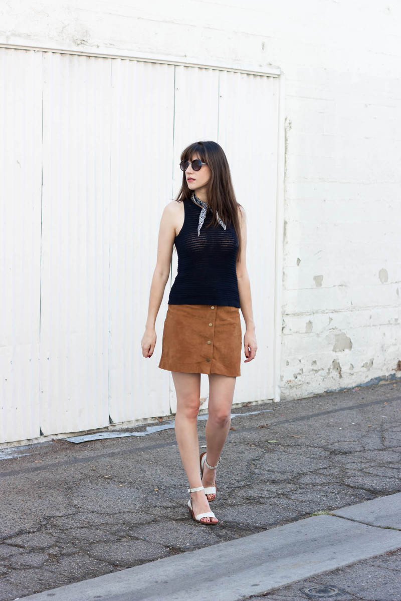Jeans and a Teacup wearing a suede skirt and navy tank