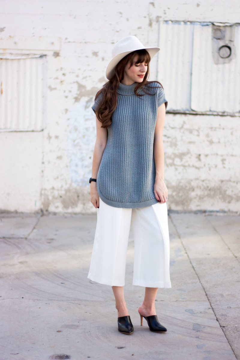 Minimalist Style Blogger wearing 1x1 tunic sweater, Kin K Hat, and white culottes