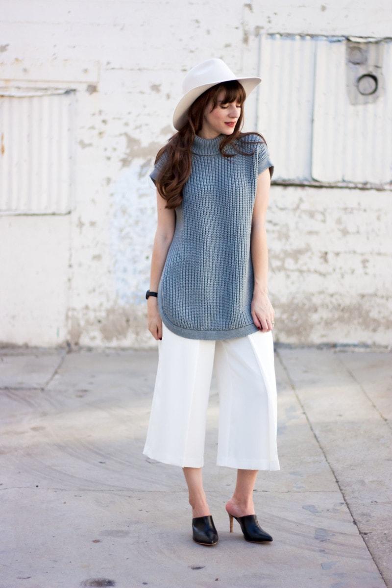 Minimalist Style Blogger wearing 1x1 tunic sweater, Kin K Hat, and white culottes