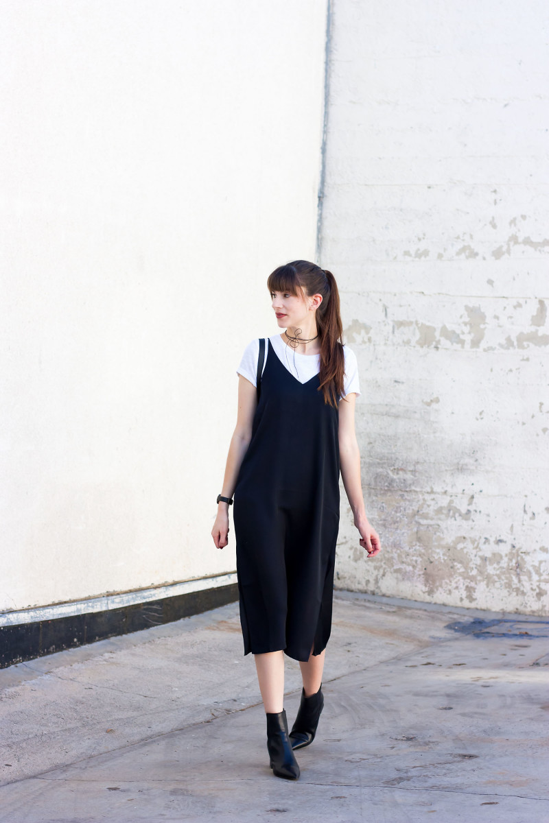 Minimalist Style Blogger wearing a midi black slip dress, white tee and black ankle booties