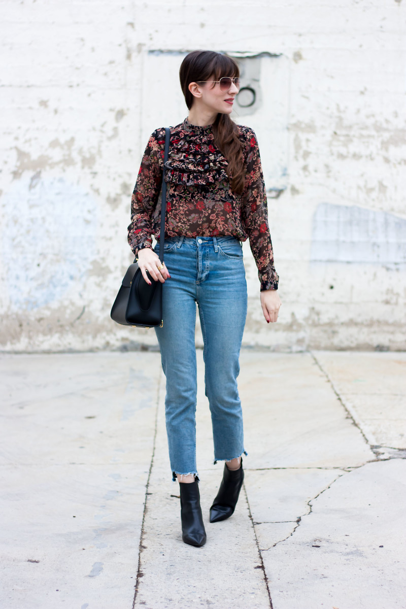 Style blogger wearing mom jeans, fall floral blouse and ankle booties