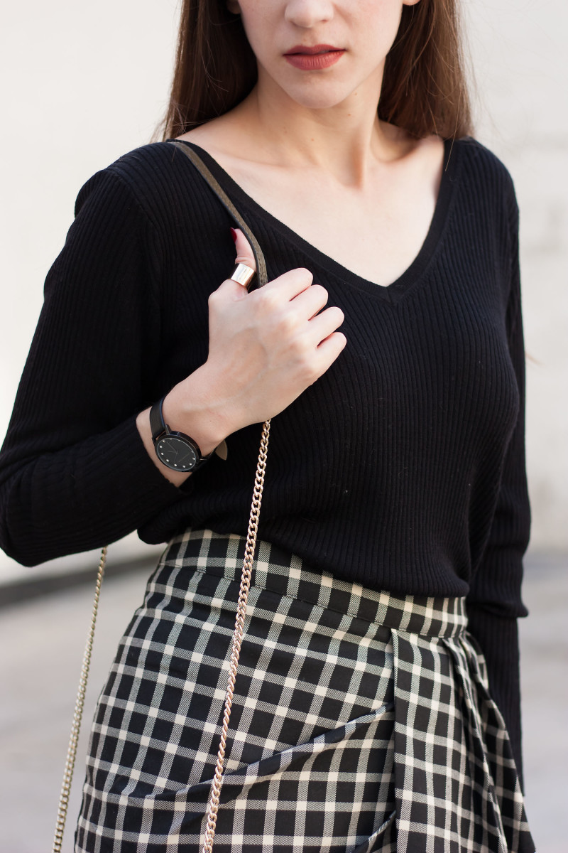 Jeans and a Teacup wearing a black v neck merino sweater and Christian Paul Watch