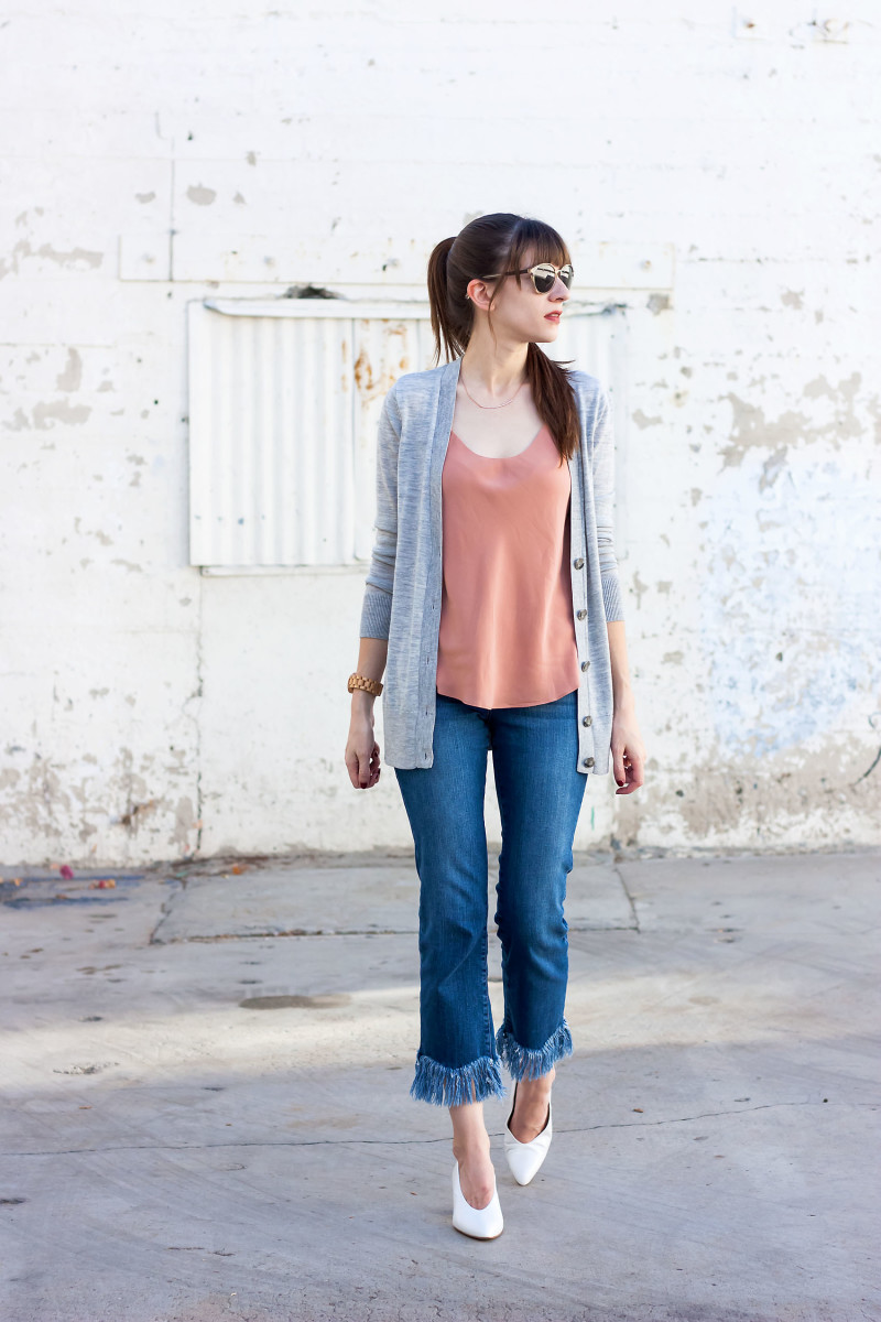 Style Blogger wearing a silk tank and fringe hem jeans