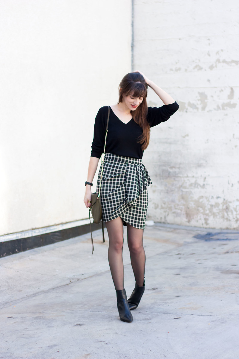 Los Angeles Fashion Blogger wearing a Grana v neck merino sweater and greylin plaid skirt