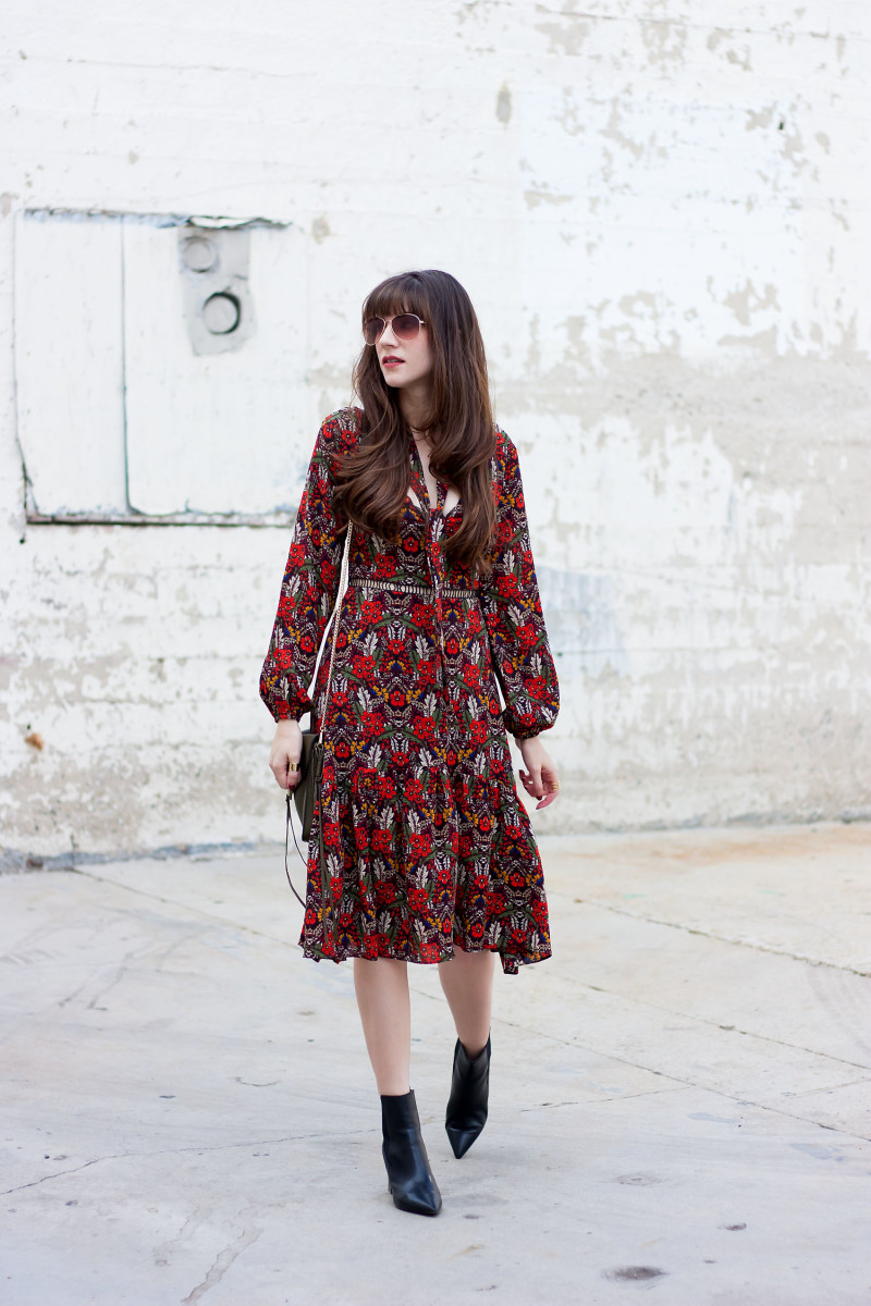 Jeans and a Teacup fashion blogger wearing a red fall floral midi dress with black ankle booties