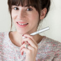 Fashion Blogger reviewing Wink eyelash growth oil