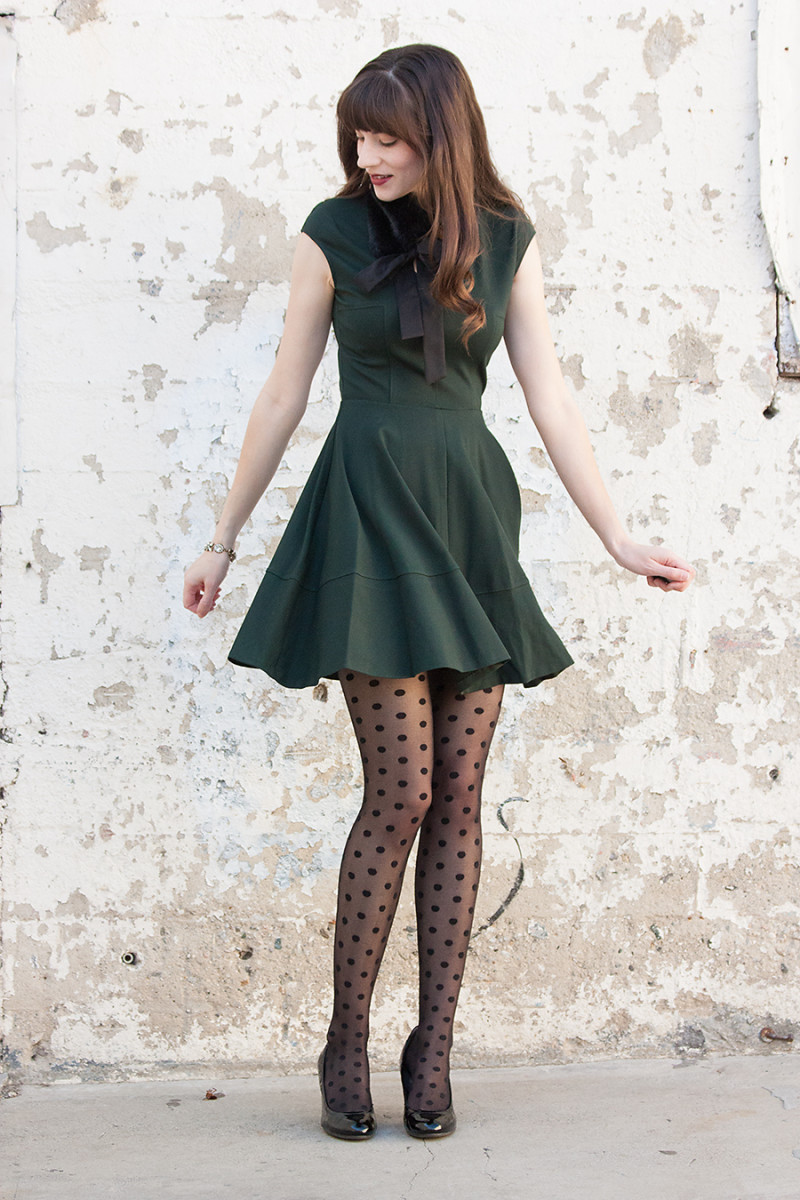 Jeans and a Teacup Style Blogger styling a dark green fit and flare dress for the holidays