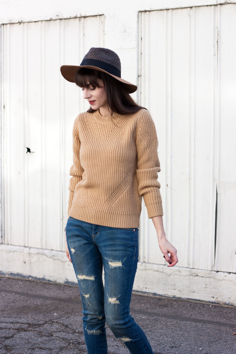 Los Angeles Style Blogger wearing a camel sweater and ripped skinny jeans