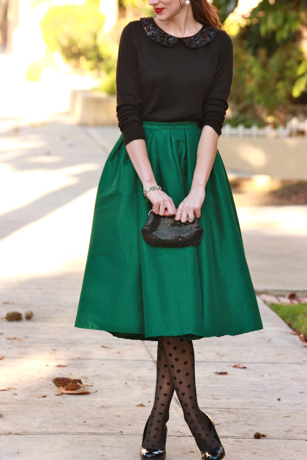 Los Angeles Fashion Blogger wearing a green midi skirt, polka dot tights and black sweater for a holiday inspired outfit