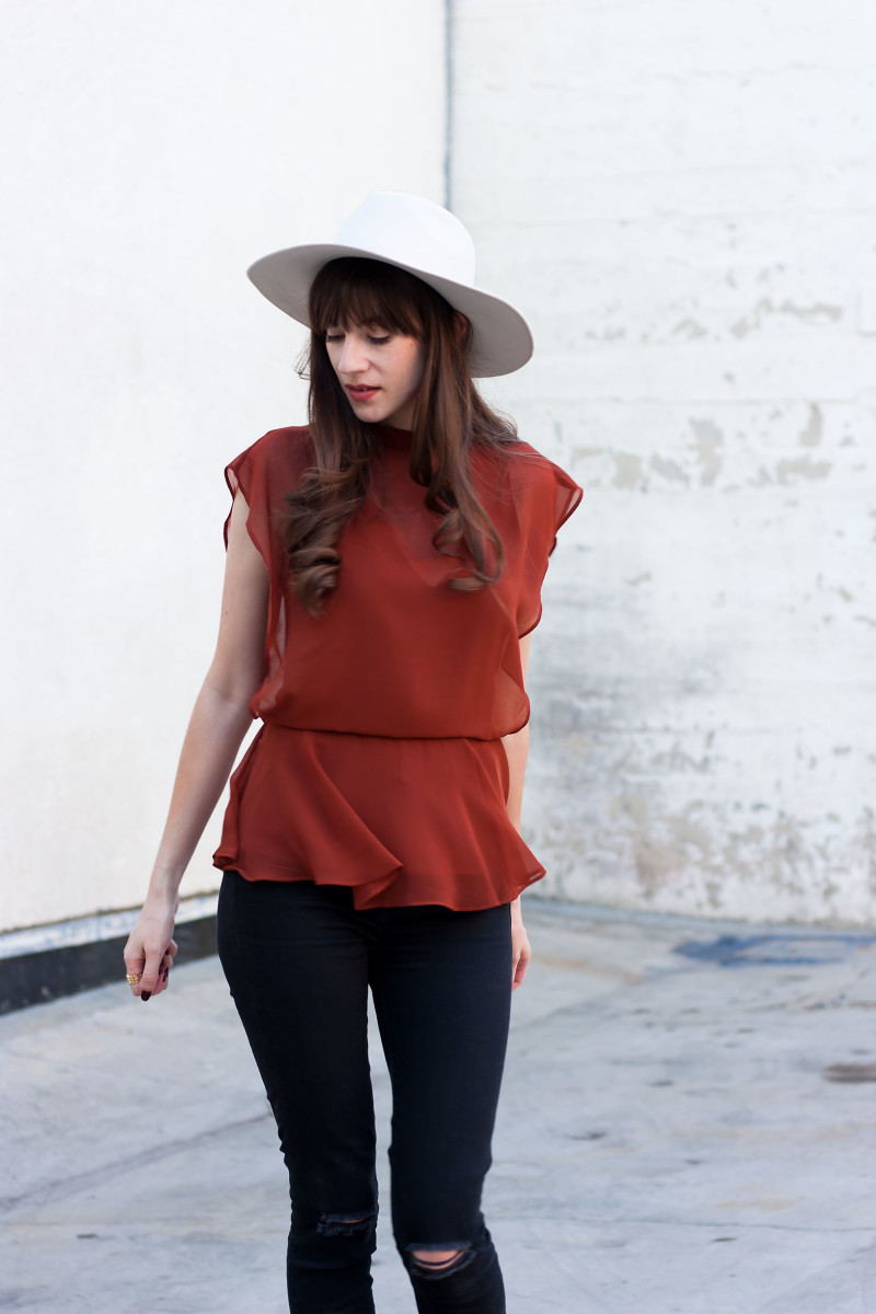 Style Blogger wearing a Line and Dot top from A La Mode Boutique and Kin K Hat