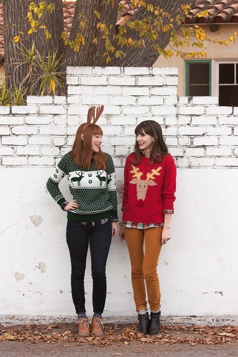 Friends wearing ugly christmas sweaters