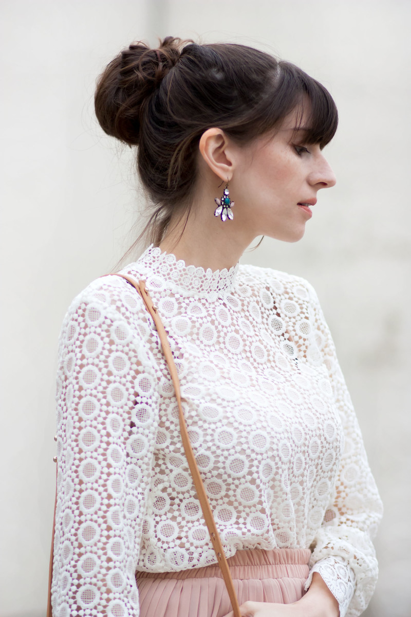Jeans and a Teacup wearing statement earrings and a high neck crochet top