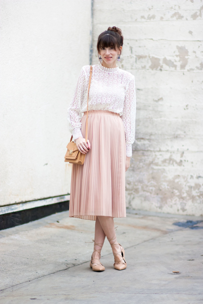 Los Angeles Style Blogger wearing blush pleated skirt and lace top for Valentine's Day