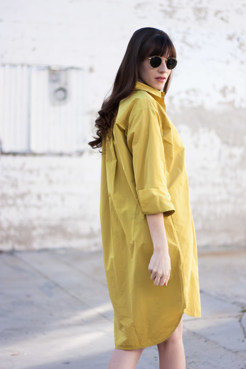 Jeans and a Teacup wearing a minimalist mustard shirtdress from ACHRO