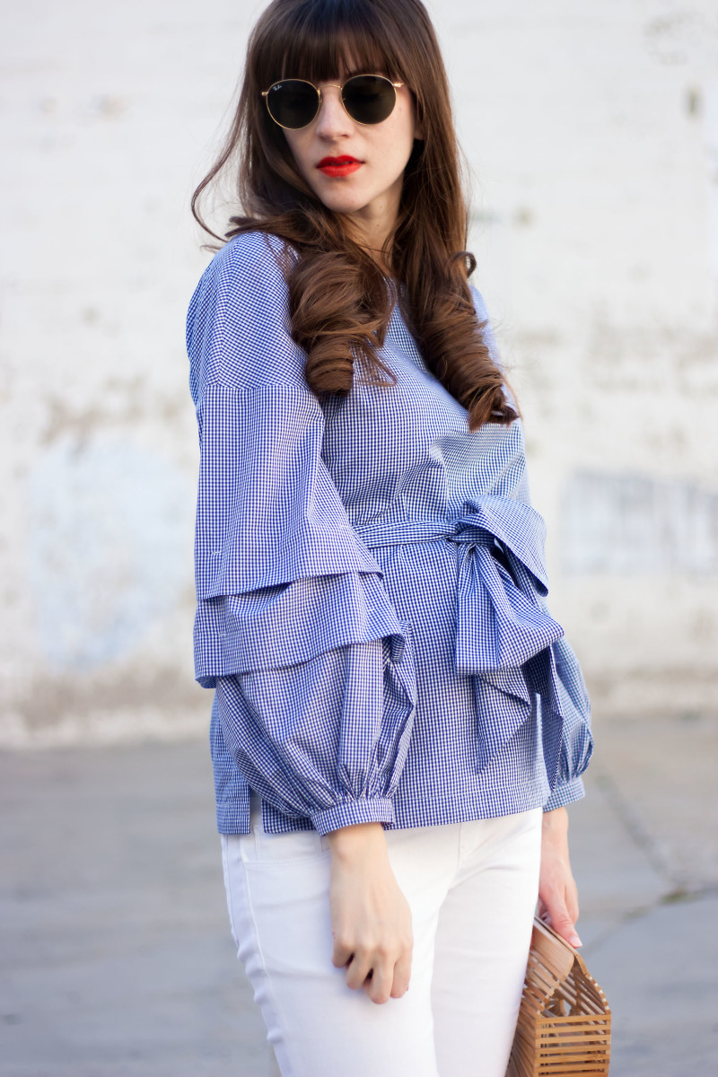 Pregnant Los Angeles Style Blogger wearing tiered sleeve shirt and ray ban sunglasses