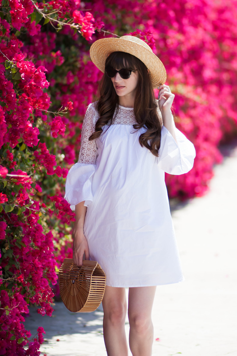 Pregnant Style Blogger wearing non-maternity white dress