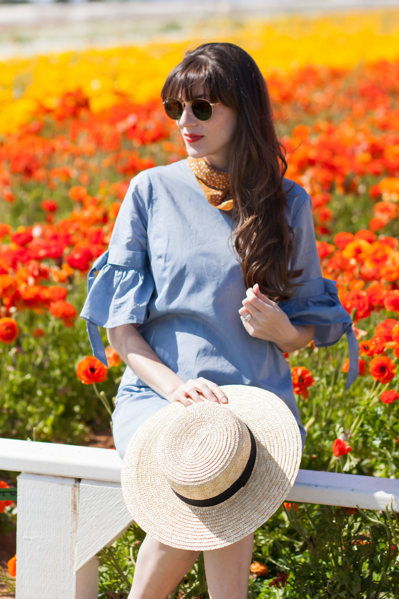 Jeans and a Teacup wearing a Who What Wear dress with boater hat at Carlsbad Flower Field