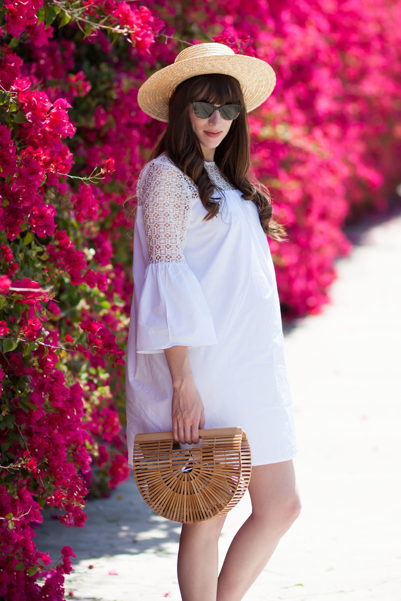 Jeans and a Teacup wearing a white eyelet summer dress and cult gaia bamboo bag