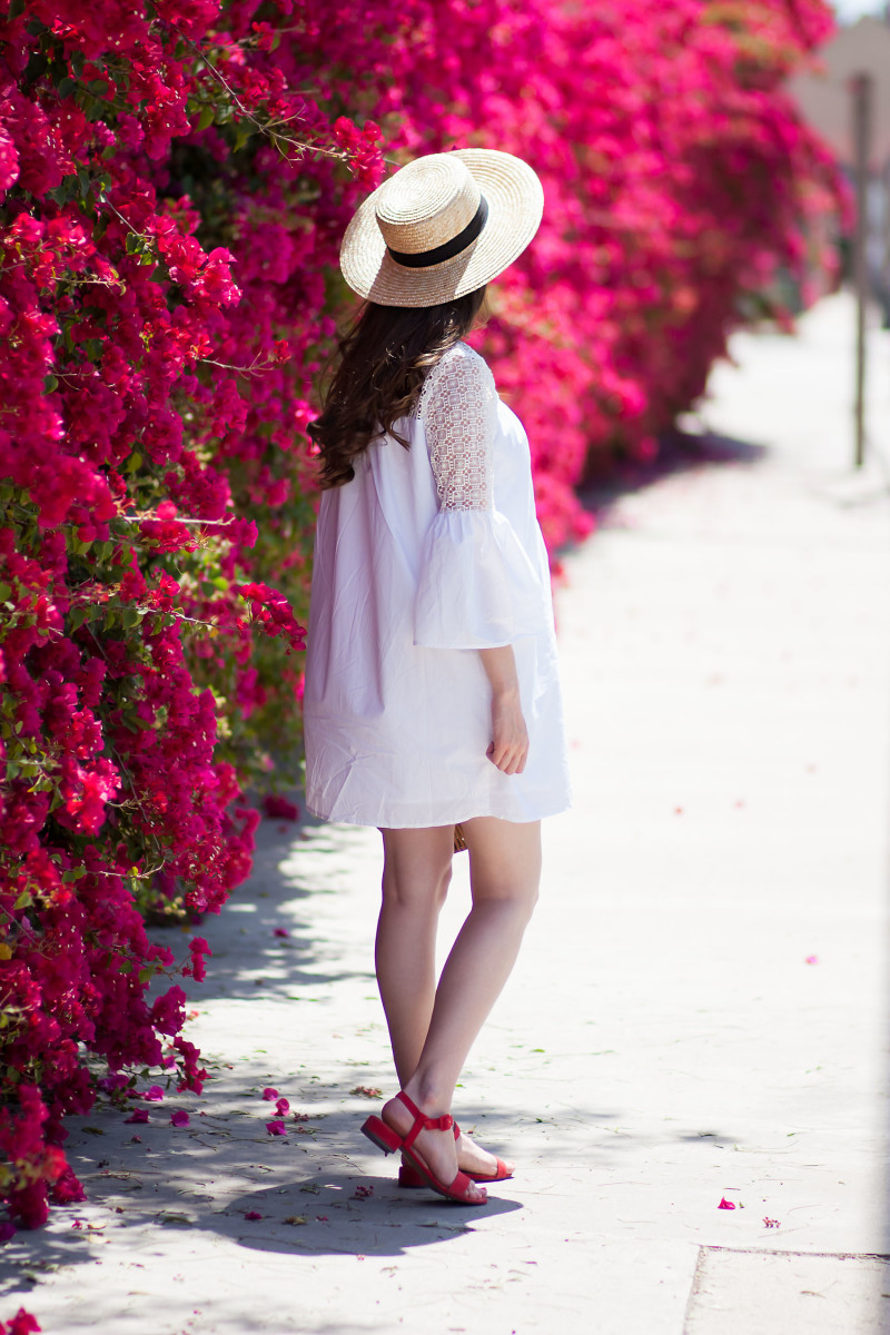 Los Angeles Style Blogger wearing a white summer dress, red suede sandals, and straw hat