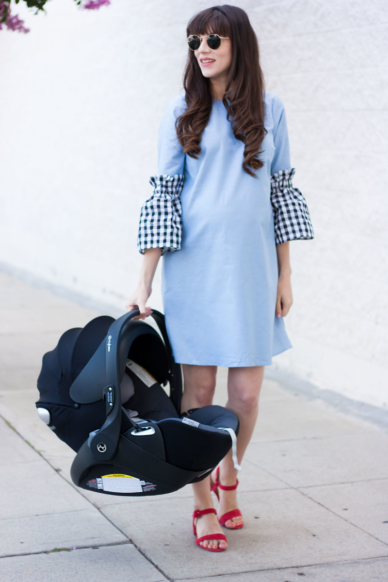 Pregnant Fashion Blogger with Cybex Cloud Q Car Seat