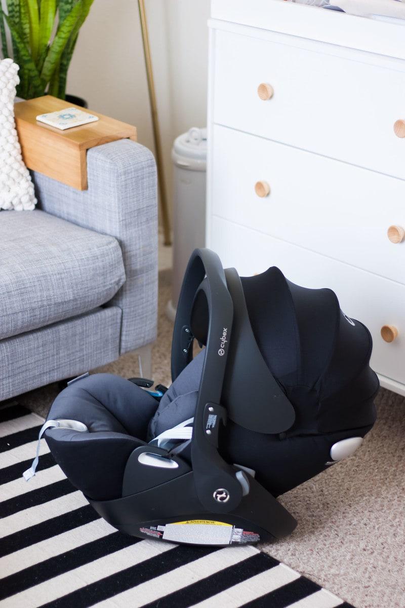 Sleek and Stylish Car Seat with hood in nursery