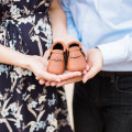 Couple holding Sweet N Sway Baby Moccasins