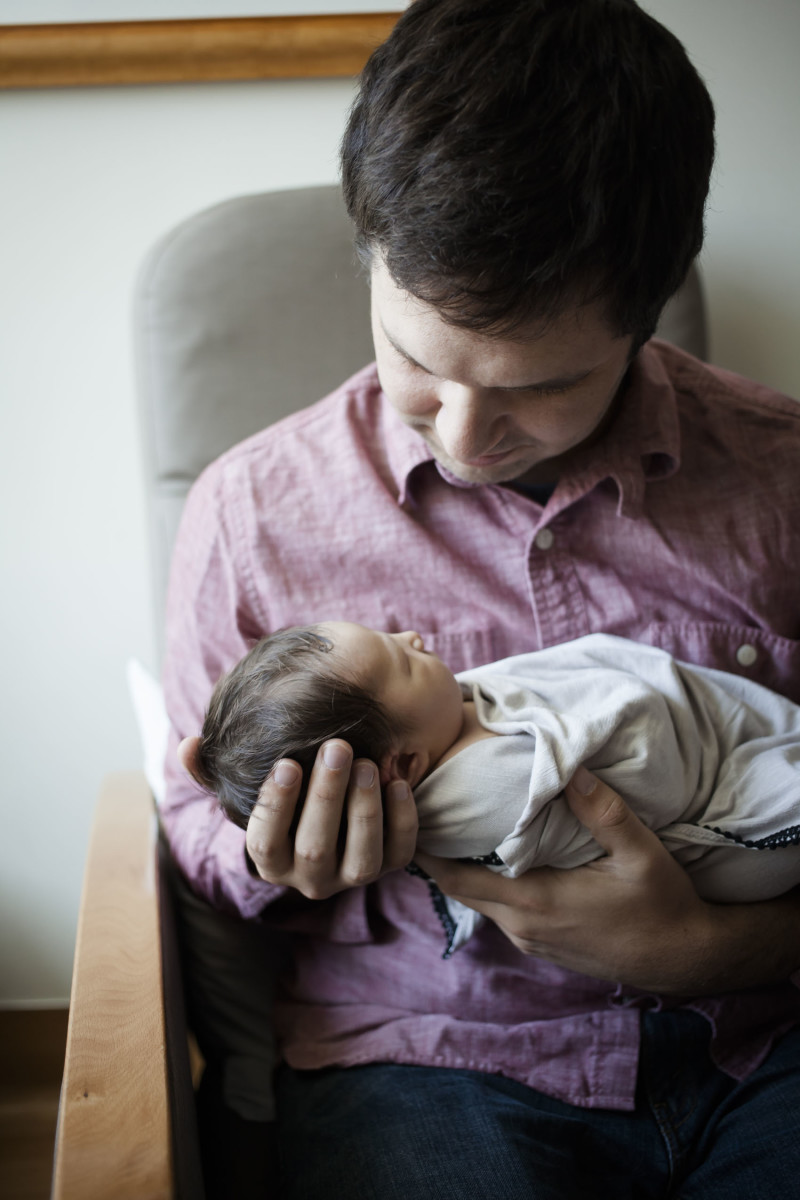 Dad with newborn baby in the hospital