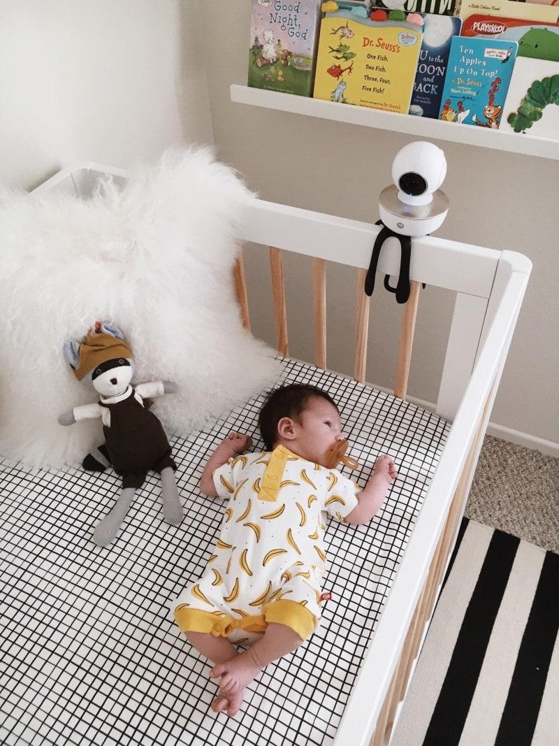 Baby wearing Zutano onsie and Motorola Baby Monitor