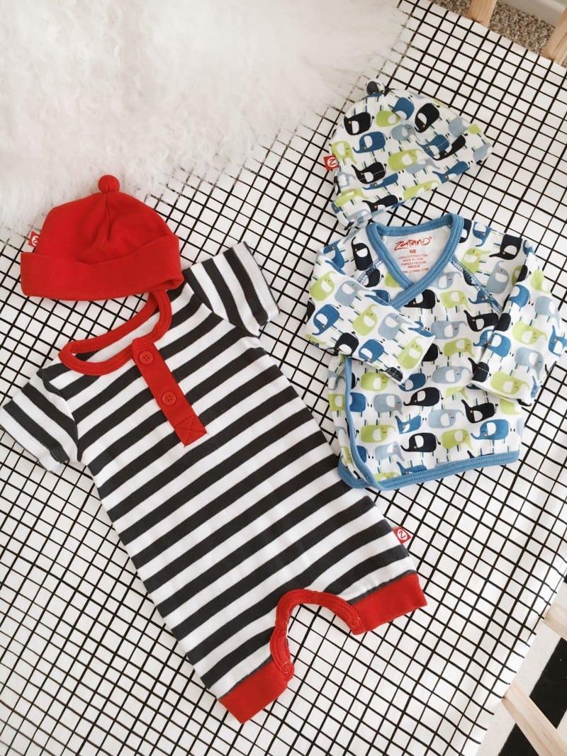 Zutano newborn outfits in crib