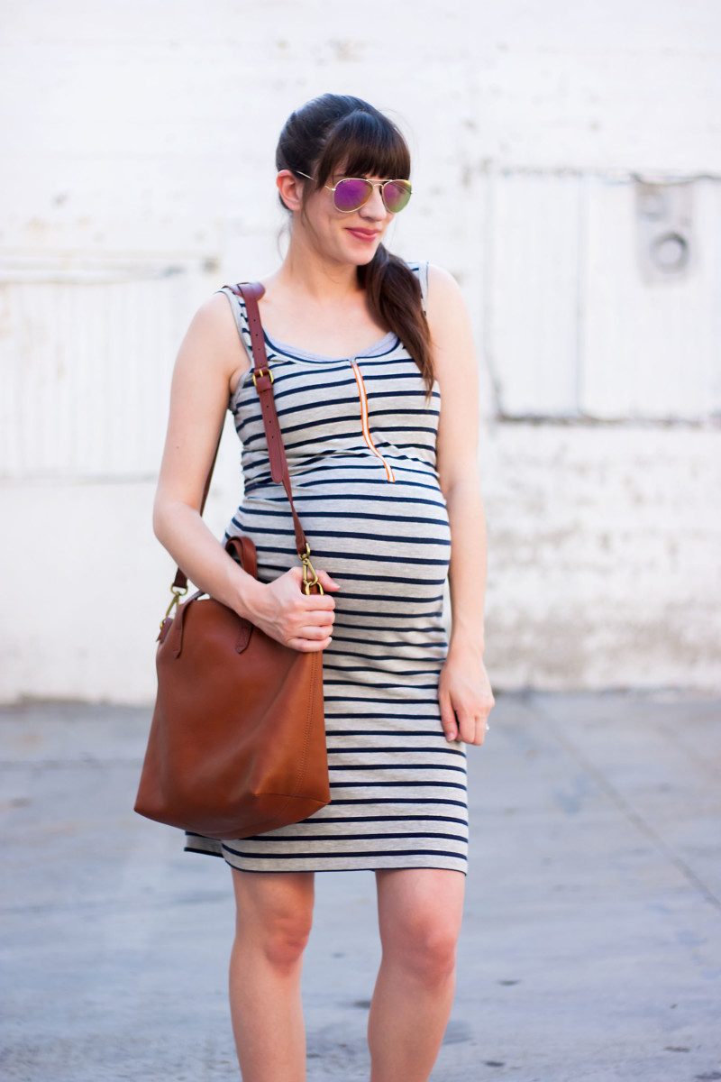 Pregnant Los Angeles Blogger wearing a striped tank nursing dress and Madewell Tote
