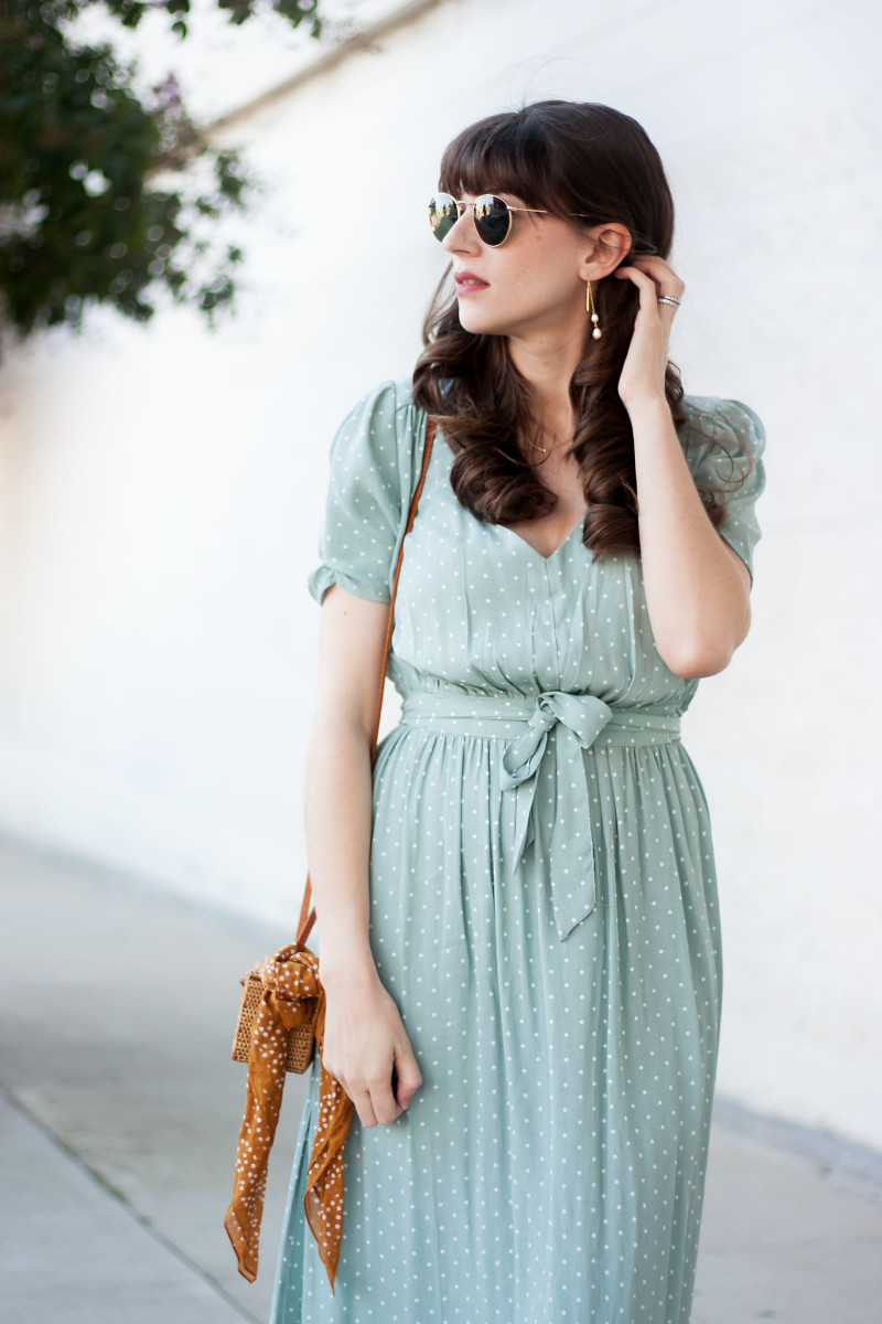 Los Angeles Fashion Blogger wearing a polka dot midi dress