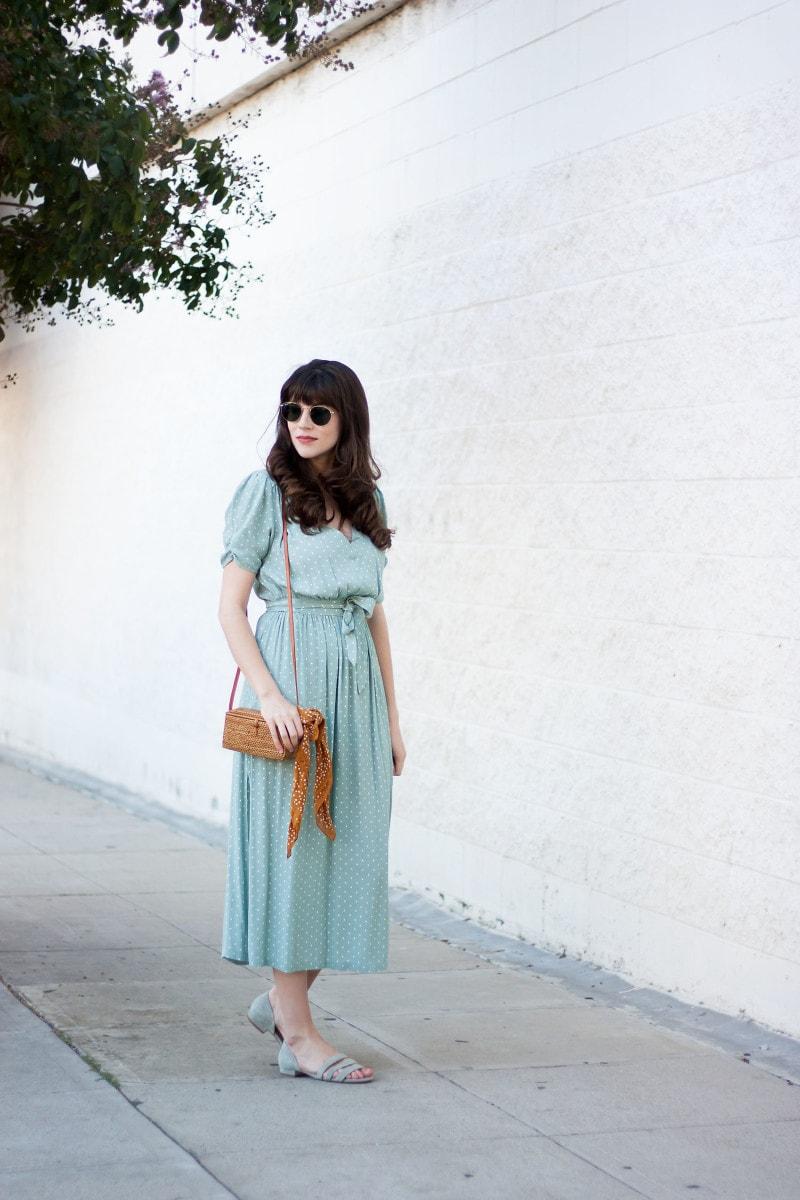 Jeans and a Teacup wearing a ladylike polka dot dress