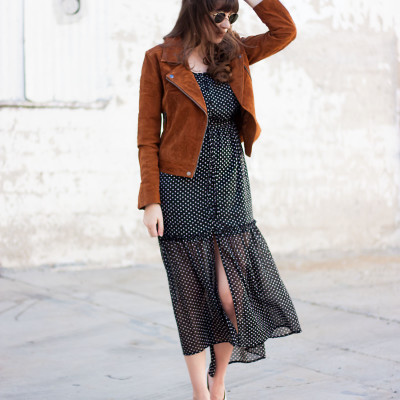 Los Angeles Style Blogger wearing a polka dot midi dress with suede jacket
