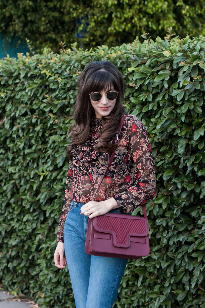 California blogger wearing Zara floral blouse and Lili Radu Crossbody bag