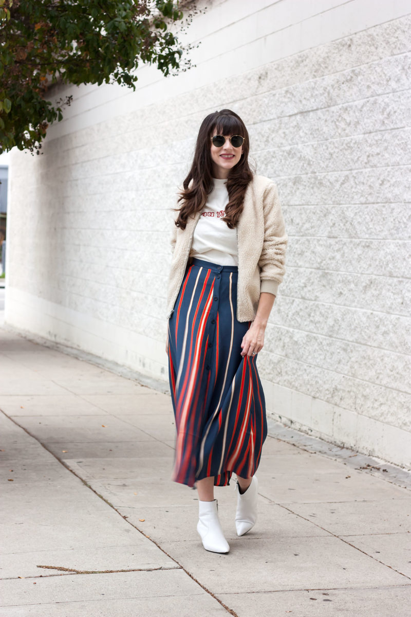 Los Angeles Style Blogger wearing retro striped midi skirt and white booties
