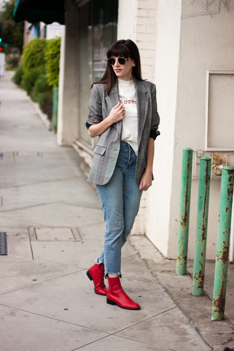 Jeans and a Teacup sharing how to wear pops of red in an outfit