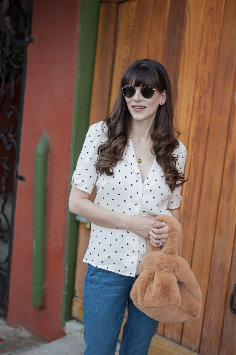 California blogger wearing polka dot Reformation Blouse and Fur grab bag