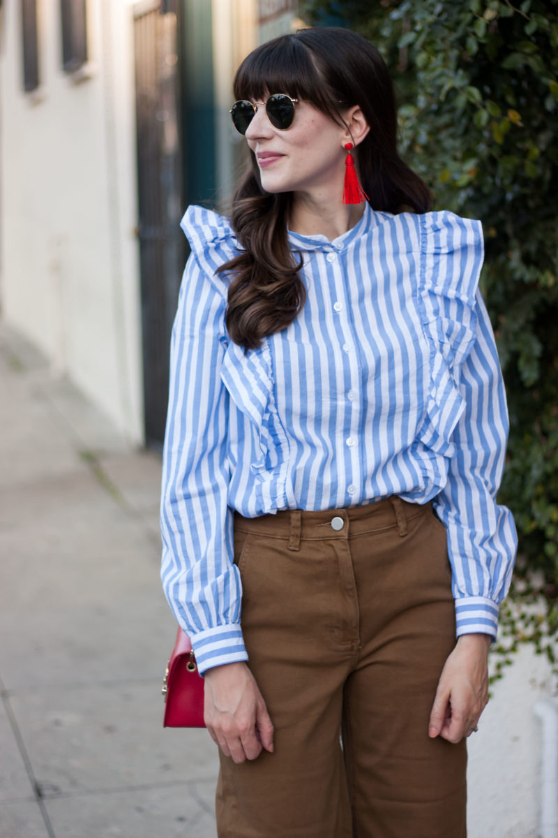 Fashion Blogger wearing Who What Wear Ruffle Shirt and Bauble Bar Earrings