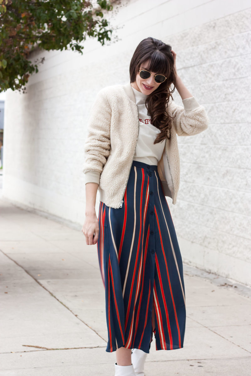 Jeans and a Teacup wearing Old Navy sherpa bomber jacket and striped button front skirt