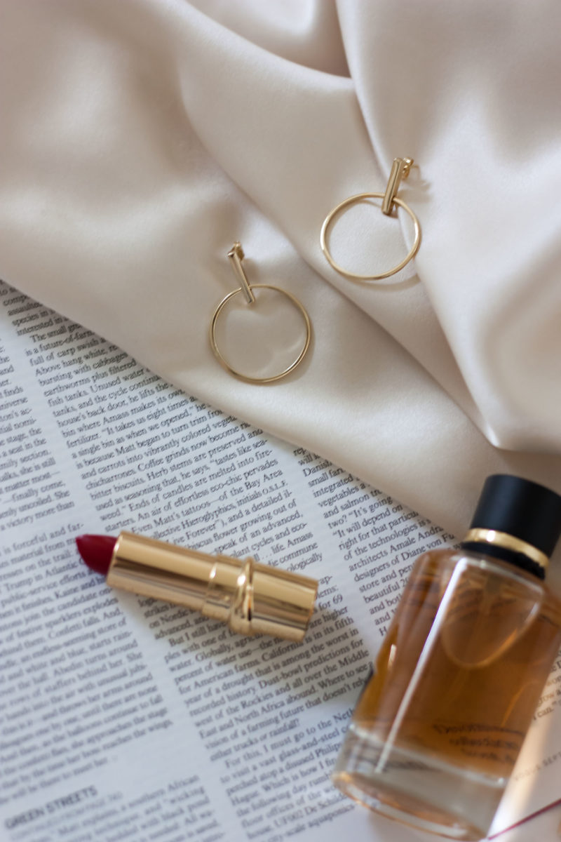 AUrate earrings with perfume and lipstick
