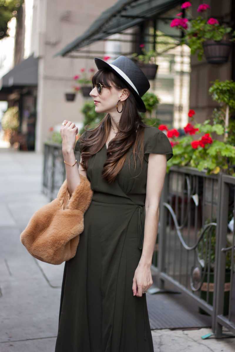 Jeans and a Teacup wearing green maxi dress and fur grab bag