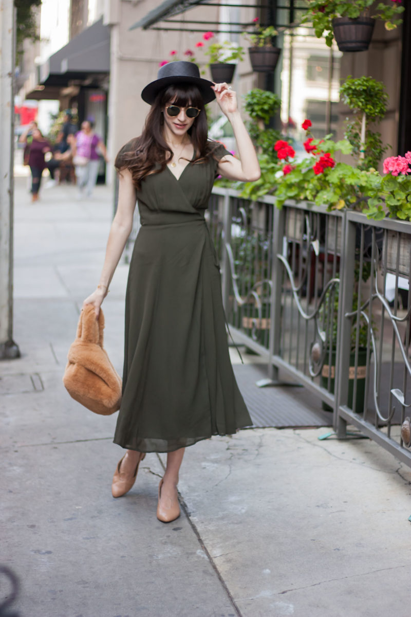 Fashion Blogger in Downtown LA wearing a summer midi dress and straw hat