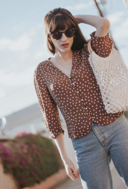 Los Angeles Fashion Blogger wearing French Style Polka Dot Top and Woven Bag